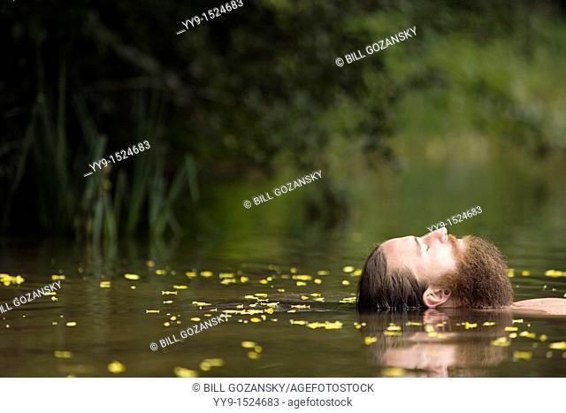 Head of Bearded Man floating in lake - Cedar Mountain, North Carolina USA