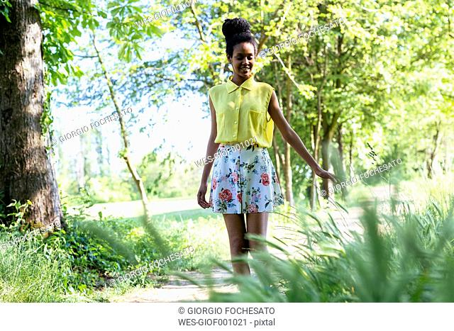 Portrait of smiling young woman in nature