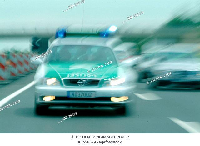DEU, Germany, NRW:Police Patrol car, on a alarm mission to an accident. Highwaypolice, Highway patrol