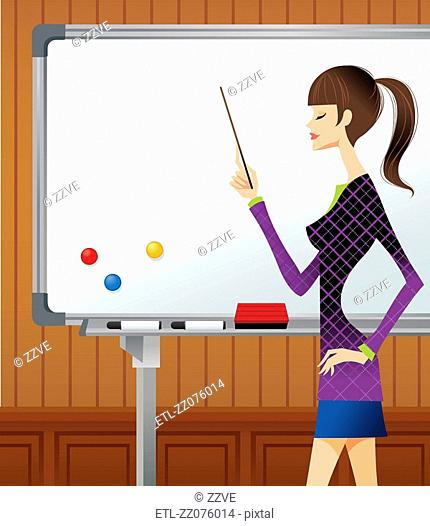 Profile of businesswoman pointing whiteboard