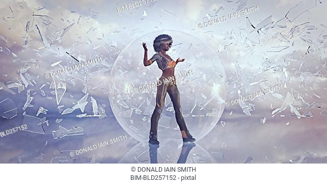 Woman standing in sphere protected from falling shards of glass