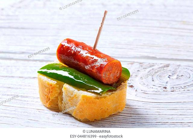 pinchos pintxos chistorra with pepper tapas from Spain sausage food