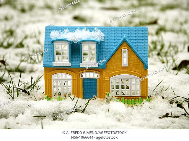 Toy house on the snow