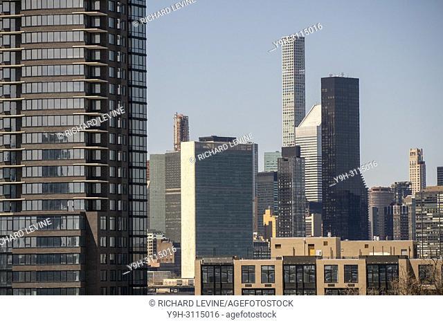 New York skyline, including 432 Park Avenue, center tall building, from the Williamsburg, Brooklyn neighborhood in New York on Sunday, April 22, 2018