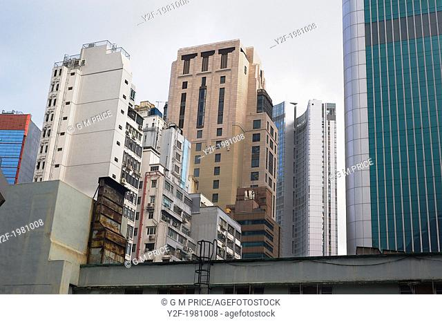 a skyline of mixed architectural styles in Central, Hong Kong