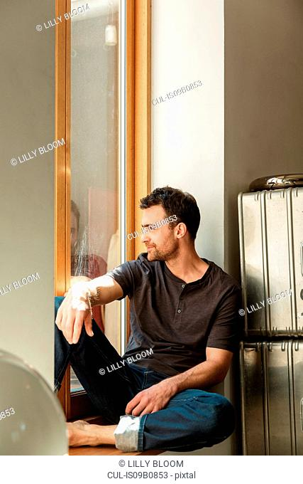 Man sitting looking out of window
