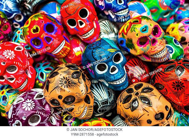 Colorful hand painted skulls (Calaveras) are sold on the market during the Day of the Dead holiday in Mexico City, Mexico, 29 October 2016