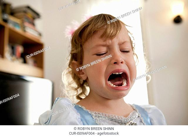 Close up of female toddler crying
