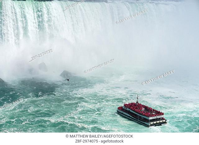 Close up of the Hornblower Cruises taking people into the mist of Niagara Falls, Canada
