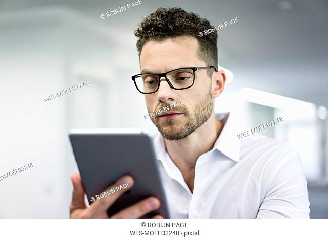 Businessman looking at tablet in office
