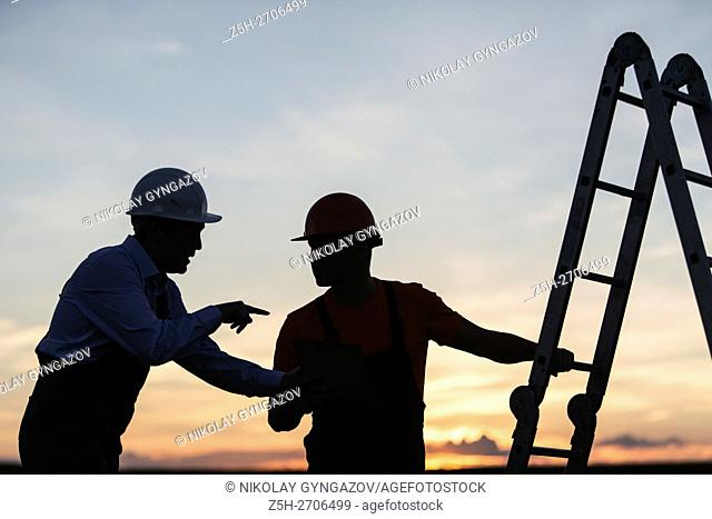 Russia. Two builders, evening shift