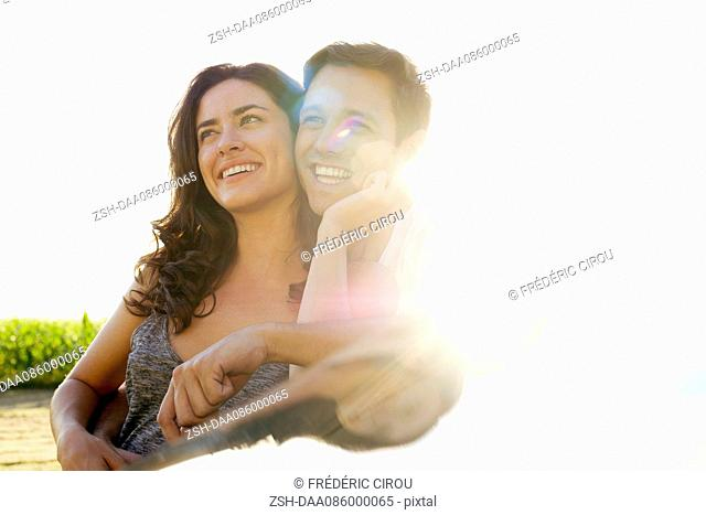 Couple embracing and looking at scenic view