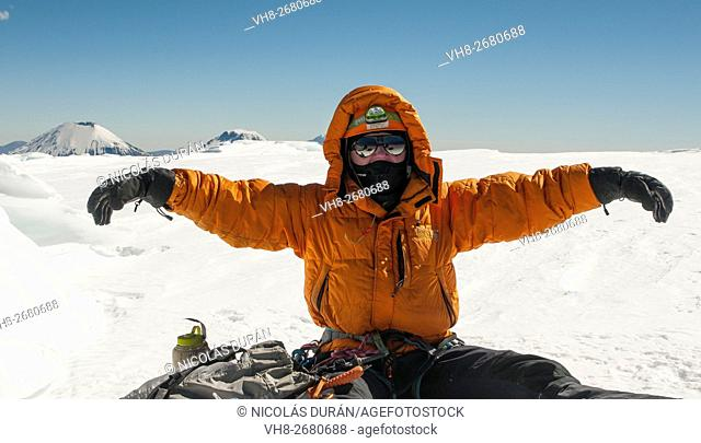 Climber on the summit of Sajama Volcano. The highest mountain in Bolivia. Department of Oruro. Bolivia. South America