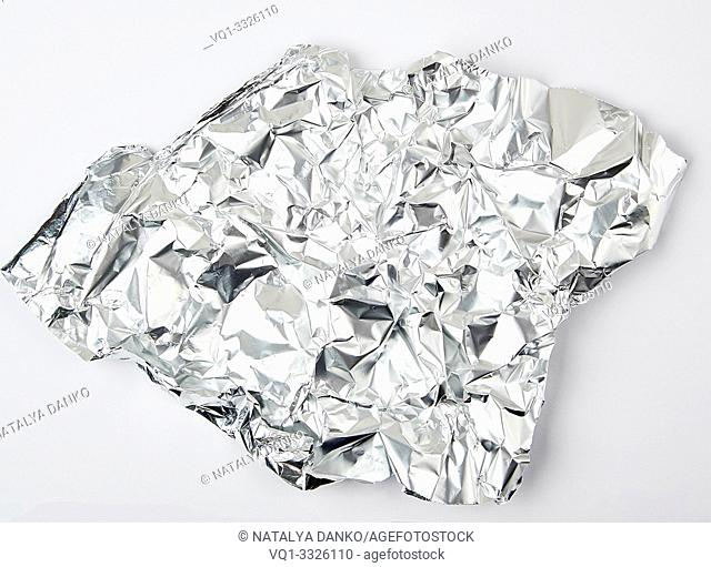 piece of crumpled foil on a white background, close up