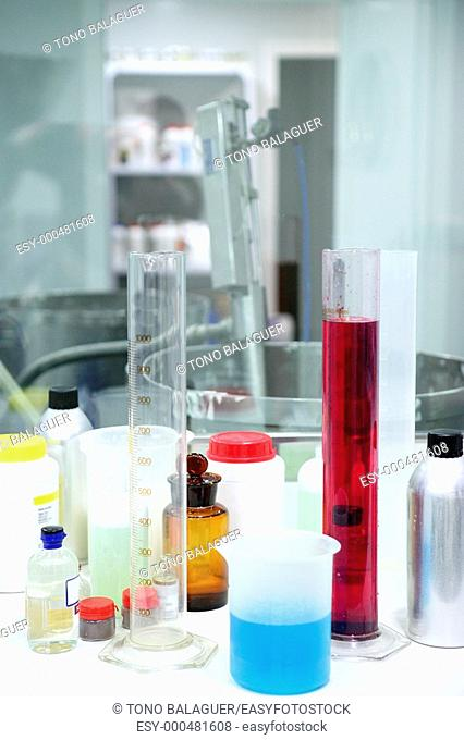 Laboratory stuff, glass cylinder vases, colorful liquids, chemical research