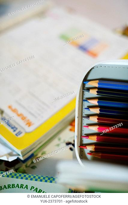 Crayons and school book