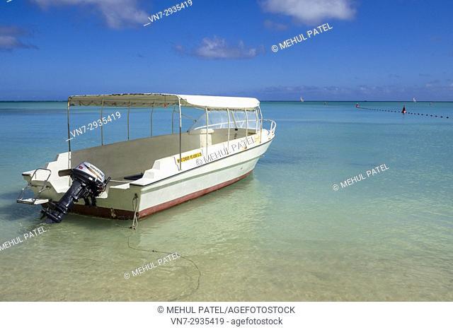 Taxi boat moored on Mon Choisy beach, Mauritius, Indian Ocean