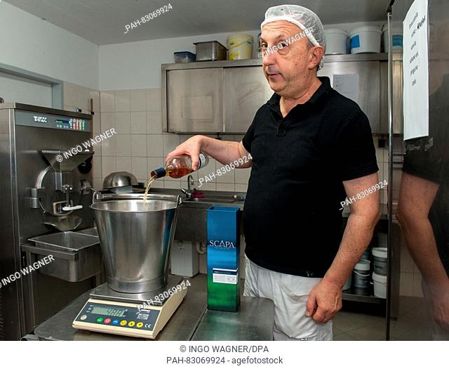 The ice-cream-maker Marco Lestam from Italy in the kitchen of his ice-cream cafe 'Bellissima' in Bremen, Germany, 11 August 2016