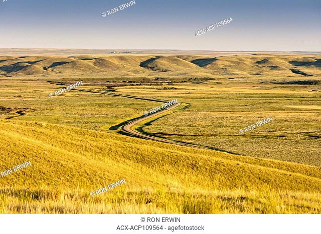 Road winding through Grasslands National Park in Saskatchewan, Canada