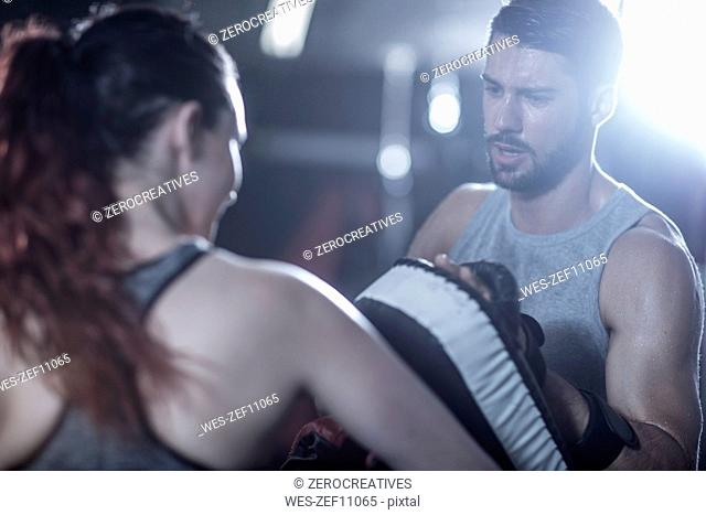Coach with female boxer