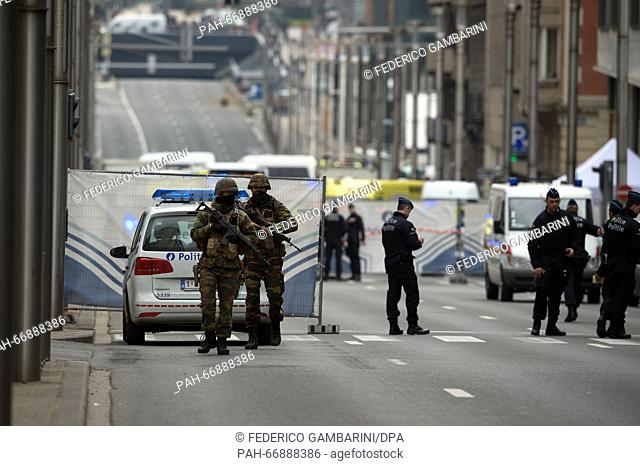 Security forces patrol the area surrounding the Maelbeek metro station inBrussels, Belgium, 22 March 2016. At least 26 people have been killed on the same day...