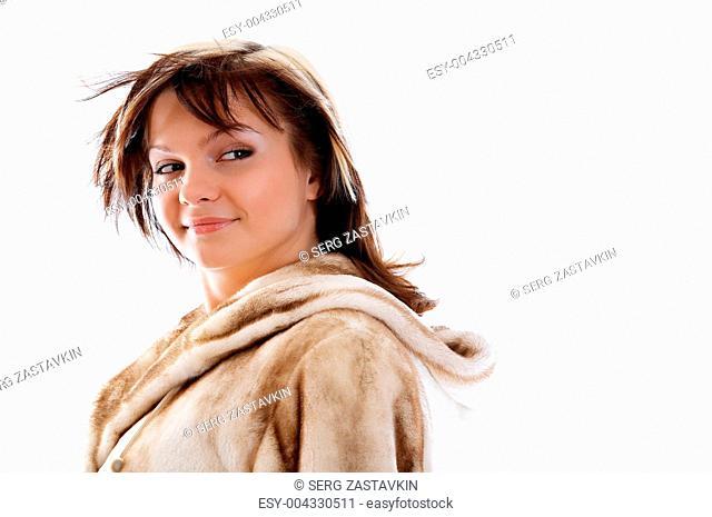 Girl in fur coat on white background