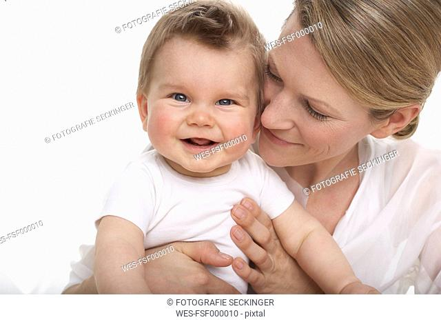 Smiling baby boy and his mother