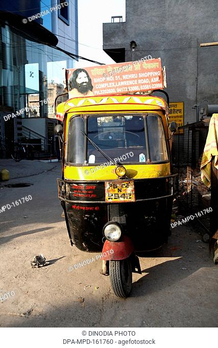 Autorickshaw carrying message about free check up at Swami Ramdev ashram in Amritsar ; Punjab ; India