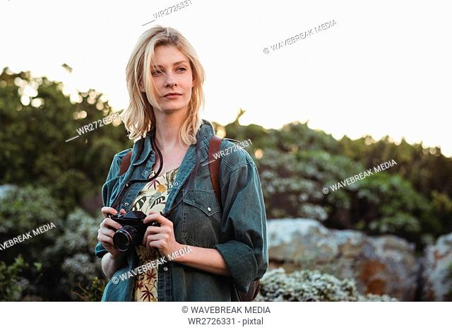 Woman holding digital camera