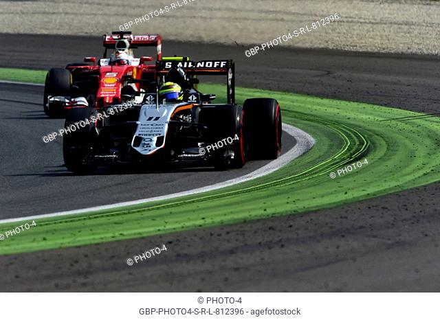 02.09.2016 - Free Practice 2, Sergio Perez (MEX) Sahara Force India F1 VJM09 and Sebastian Vettel (GER) Scuderia Ferrari SF16-H