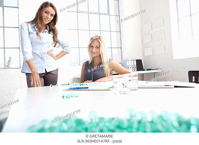 Businesswomen working with glass beads