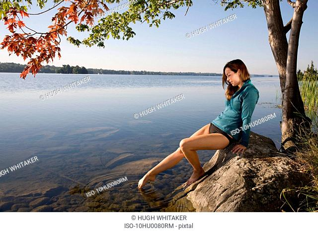 Woman testing water with toe