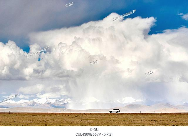 Storm cloud over distant mountains, Namucuo, Xiang, China