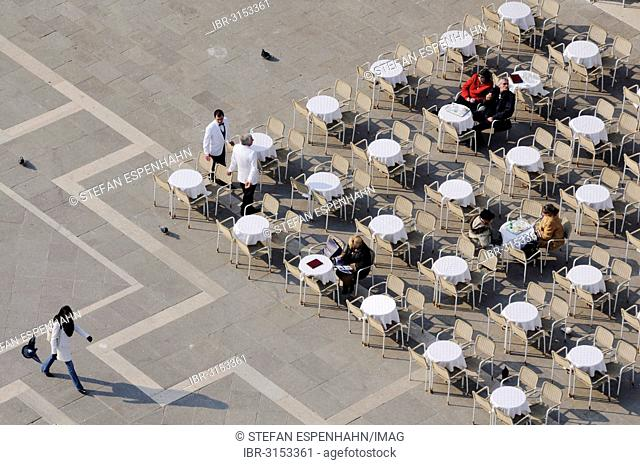 Tables and chairs in St. Mark's Square, from above
