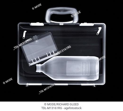 X-ray of a bag containing a bottle and a filofax