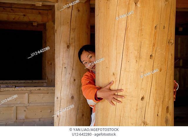 one girl hug big wood