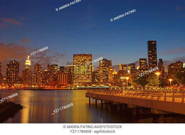 Midtown Manhattan Skyline and Gantry Plaza State Park at twilight