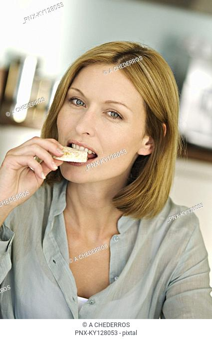 Portrait of a woman eating rice cake