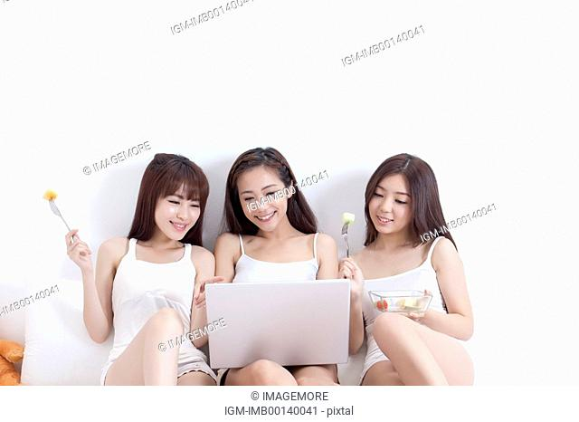 Young women sitting and relaxing with smile together