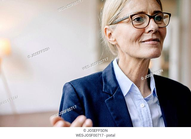 Portrait of confident businesswoman wearing glasses
