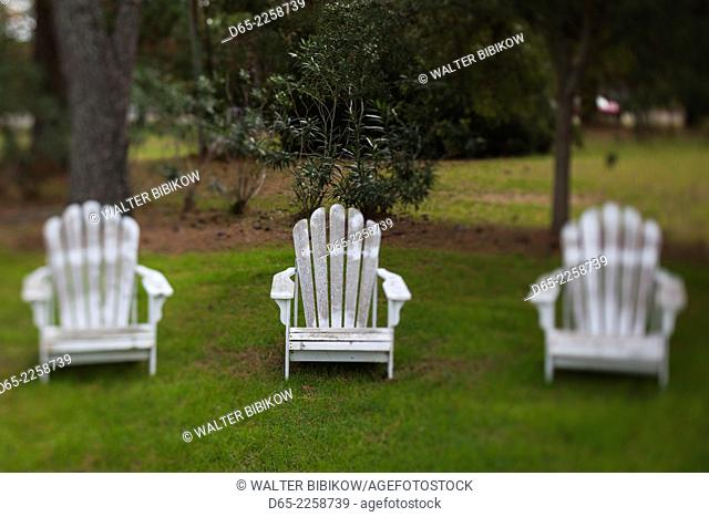 USA, North Carolina, Outer Banks National Seashore, Corolla, old Adirondack lawn chairs, defocussed