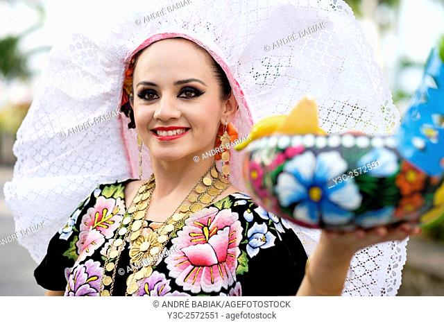 Portrait of young woman smiling. Puerto Vallarta, Jalisco, Mexico. Xiutla Dancers - a folkloristic Mexican dance group in traditional costumes representing the...