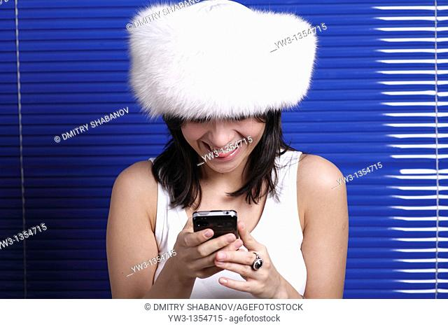 Smiling beautiful woman in hat talking by phone  Beautiful with telephone, headset, headphones series