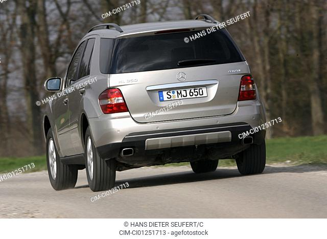 Mercedes ML 350, model year 2005-, silver, driving, diagonal from the back, rear view, country road