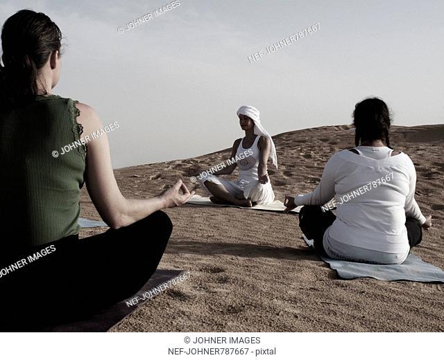Women meditating in the desert, Tunisia