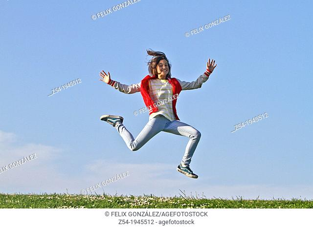 Young girl jumping in air, Spain
