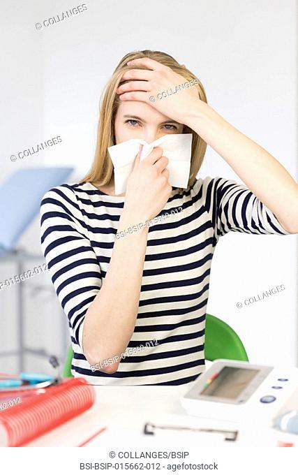 Female patient blowing her nose