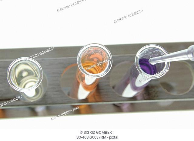 Close up of test tubes with liquid