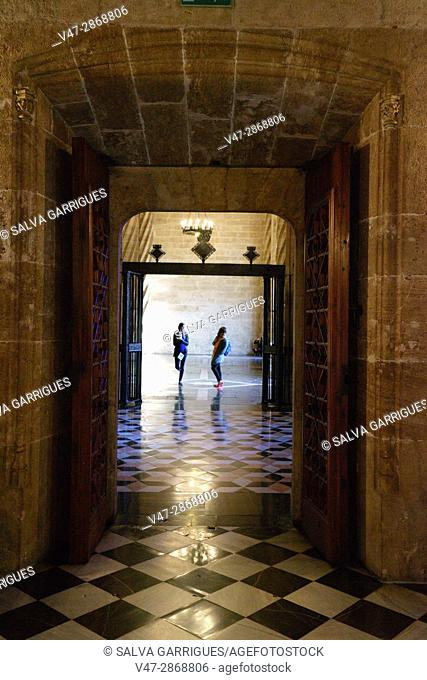 Two tourists in the corridor of the Longa de la Seda, Valencia, Spain