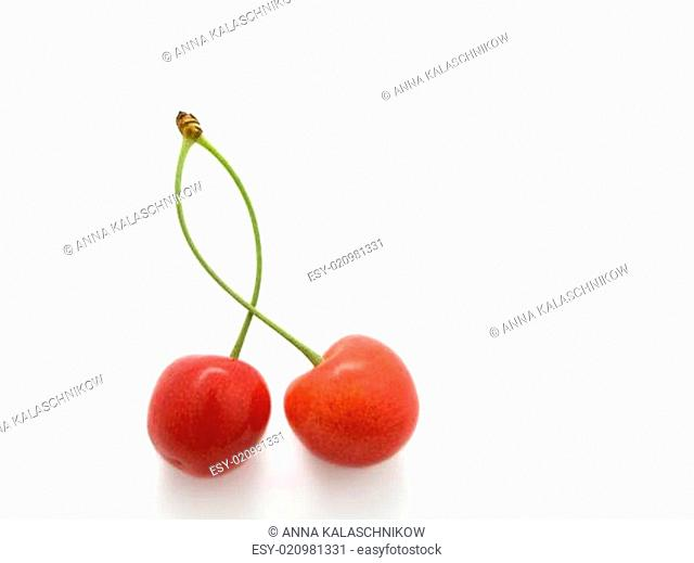 sweet cherry with a green leaf on white background